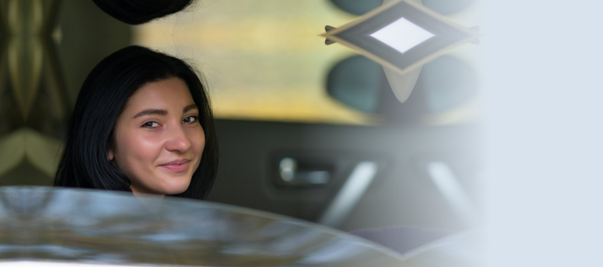 smiling woman inside car