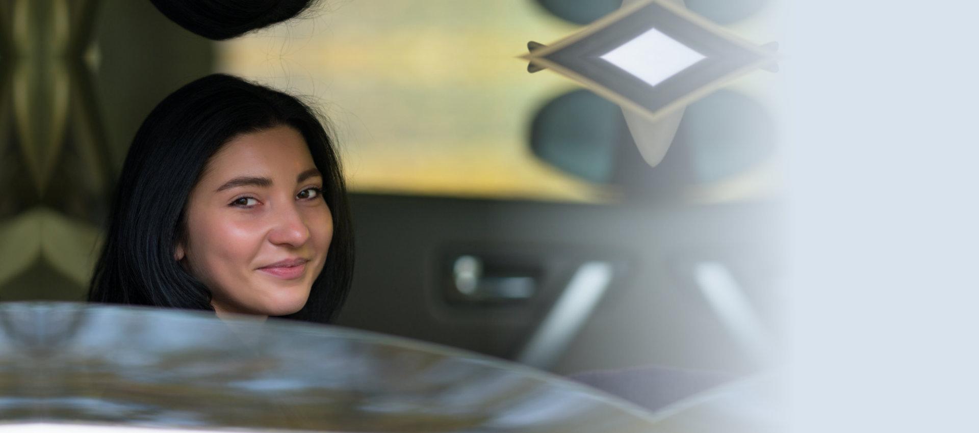 smiling woman inside car