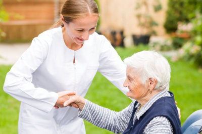 young carer helping the elderly woman