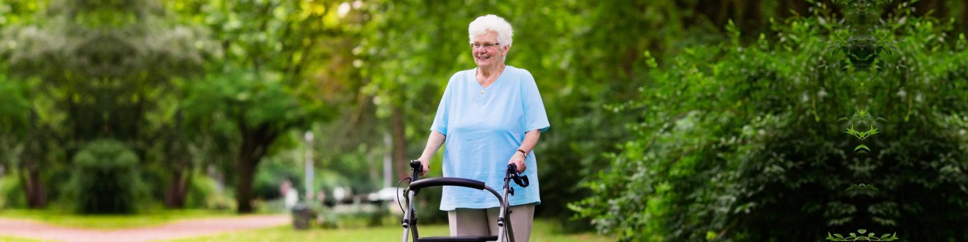 senior handicapped lady with a walking disability enjoying a walk